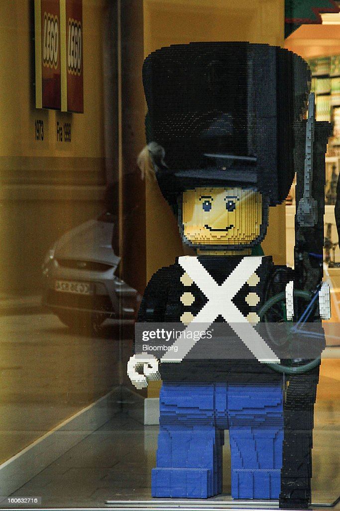 A giant model soldier made of building blocks stands on display in the window of a Lego A/S toy store in Copenhagen, Denmark, on Friday, Jan. 11, 2013. The 'Lego Friends' series, introduced in January in most markets, is Lego's sixth attempt over the years to target girls and the 'most significant' new product in a decade, according to Chief Executive Officer Joergen Vig Knudstorp. Photographer: Freya Ingrid Morales/Bloomberg via Getty Images
