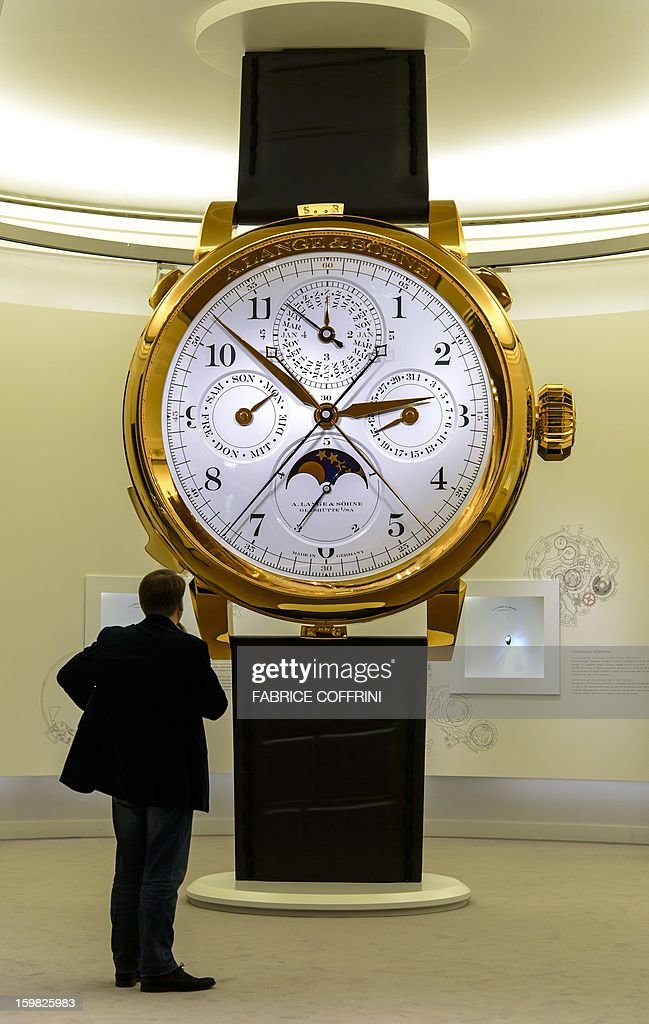 A giant model watch by watchmaker 'A. Lange & Soehne', part of luxury goods group Richemont, is displayed during the opening day of the 'Salon International de la Haute Horlogerie' (SIHH) a professional fair in fine watchmaking on January 21, 2013 in Geneva. Swiss manufacturer of luxury goods Richemont announced sales meet expectations for the third quarter of its 2012 fiscal year to Euro 2.8 billion, up 5% at constant exchange rates and 9% in the real exchange rate. AFP PHOTO / FABRICE COFFRINI