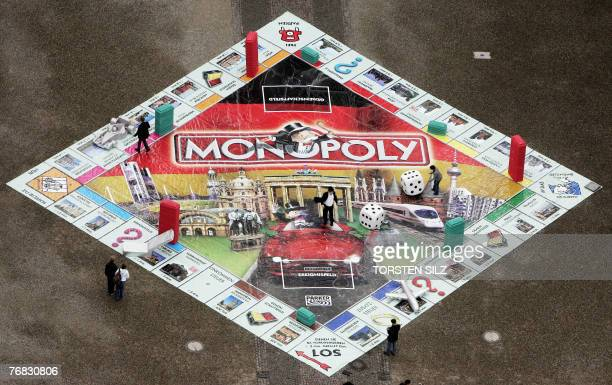 A giant Monopoly game is displayed in the courtyard of the castle of Saarbruecken western Germany 18 September 2007 Saarbruecken managed to be...