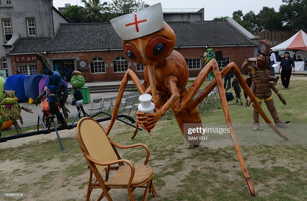 A giant mosquito is on display during a press conference to promote an exhibition of the Wonderland of Animals and Insects in Taipei on March 19, 2013. The organizer Paperwindmill Arts Foundation said the activity will held at central Taichung city between April 4-14. AFP PHOTO / Sam YEH