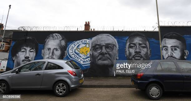 A giant mural created by artist Richard Wilson depicts Leicester City's Japanese striker Shinji Okazaki Leicester City's Danish goalkeeper Kasper...