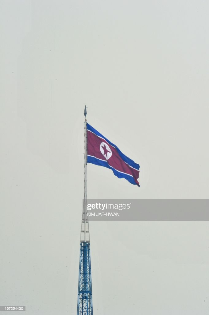 A giant North Korean flutters on top of a steel tower in the middle of a showcase North Korean village in the demilitarised zone on April 23, 2013. Tensions simmer along the world's last Cold War frontier after weeks of hostile threats from North Korea and its preparations for potential missile launches. AFP PHOTO / KIM JAE-HWAN