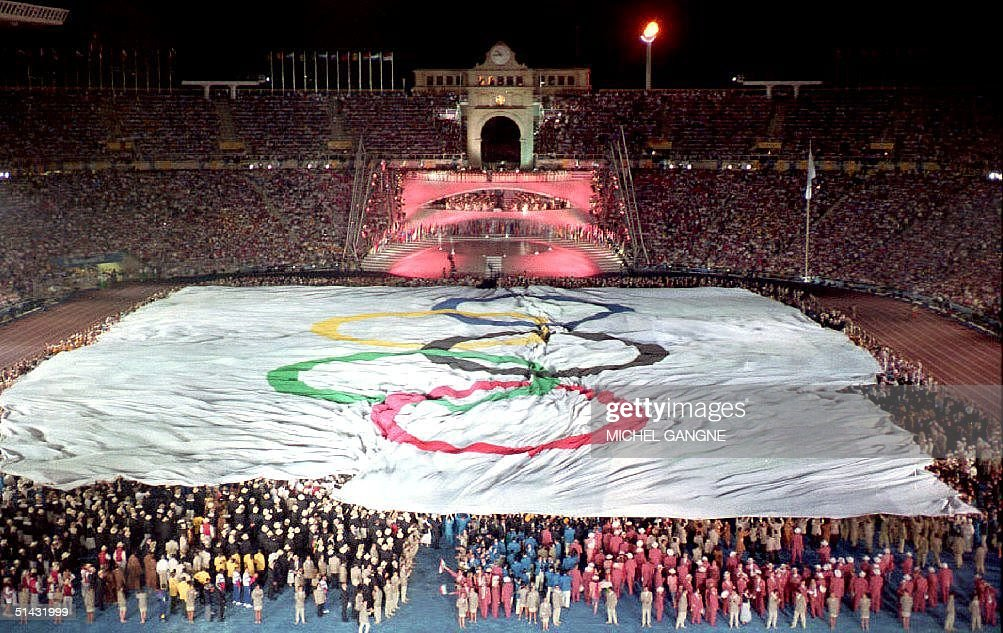 A giant Olympic flag covers the pitch during the opening ceremony of the XXVth summer Olympic Games at Montjuic stadium 25 July 1992