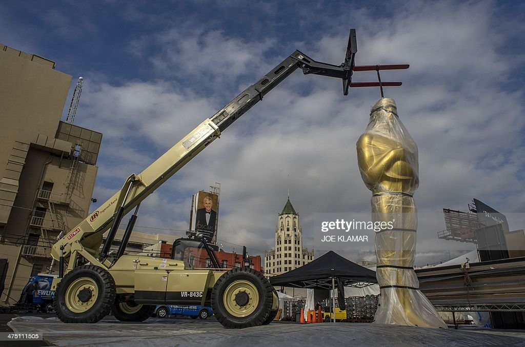 A giant Oscar statue waits to be transported to Hollywood Boulevard in front of the Dolby Theater on February 26 2014 in Hollywood California during...
