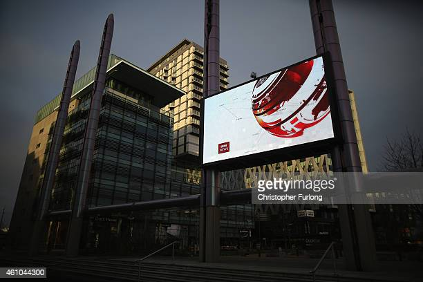 A giant outdoor television screen broadcasts the BBC News at Media City in Salford Quays which is home to the BBC ITV television studios and also...