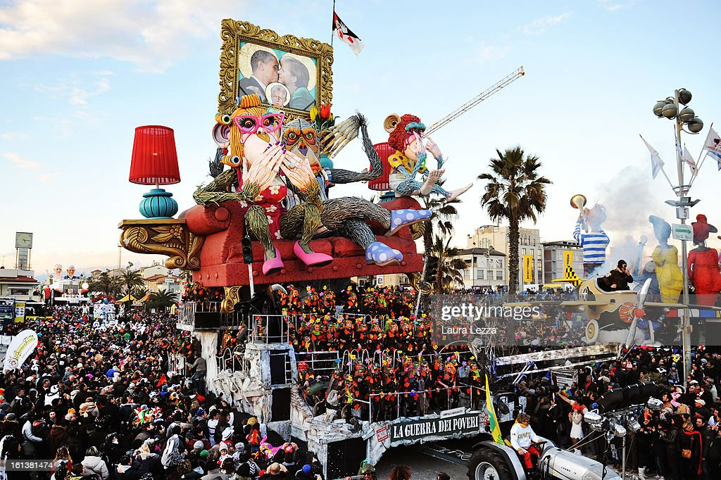 A giant paper mache float carrying a picture of US President Barack Obama, Chancellor of Germany <a gi-track='captionPersonalityLinkClicked' href=/galleries/search?phrase=Angela+Merkel&family=editorial&specificpeople=202161 ng-click='$event.stopPropagation()'>Angela Merkel</a> and Prmie Minister of Italy Mario Monti moves through the streets of Viareggio during the traditional Carnival parade on February 10, 2013 in Viareggio, Italy. The Carnival of Viareggio is considered one of the most important carnivals in Italy and is characterised by its giant paper mache floats representing caricatures of popular characters, politicians and fictional creations.