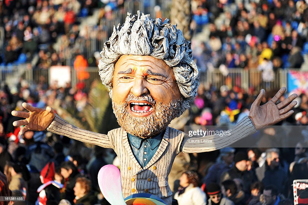 A giant paper mache float representing Italian comedian and politician Beppe Grillo moves through the streets of Viareggio during the traditional Carnival parade on February 10, 2013 in Viareggio, Italy. The Carnival of Viareggio is considered one of the most important carnivals in Italy and is characterised by its giant paper mache floats representing caricatures of popular characters, politicians and fictional creations.