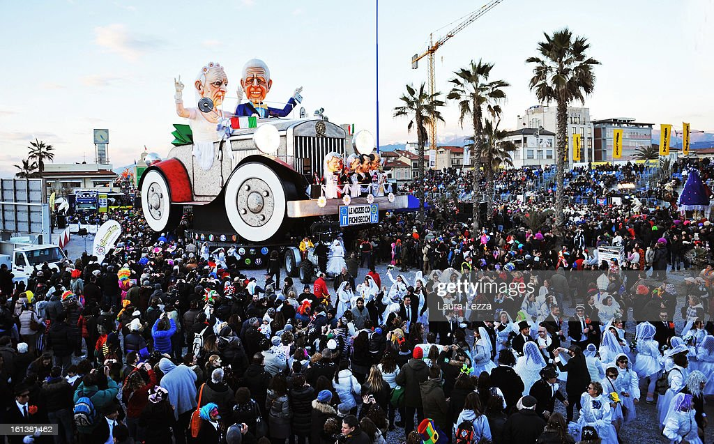 A giant paper mache float representing Italian President Giorgio Napolitano (L) and Italian Prime Minister Mario Monti moves through the streets of Viareggio during the traditional Carnival parade on February 10, 2013 in Viareggio, Italy. The Carnival of Viareggio is considered one of the most important carnivals in Italy and is characterised by its giant paper mache floats representing caricatures of popular characters, politicians and fictional creations.
