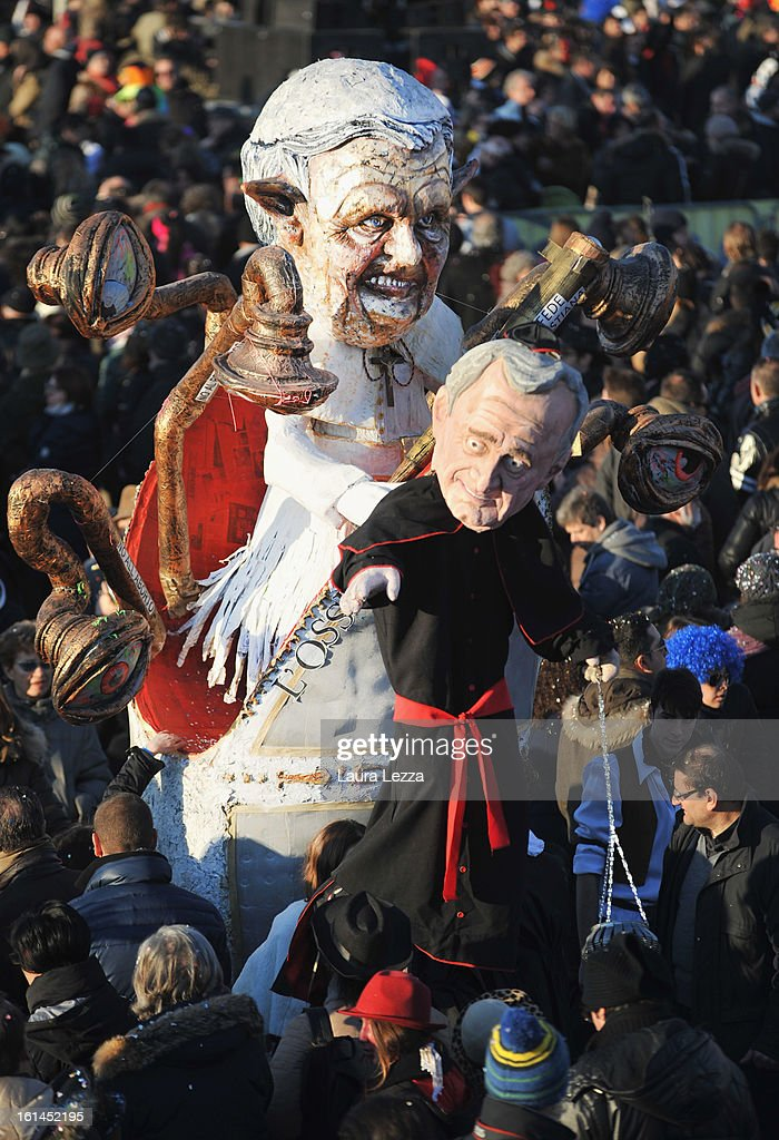 A giant paper mache float representing Pope Benedict XVI moves through the streets of Viareggio during the traditional Carnival parade on February 10, 2013 in Viareggio, Italy. The Carnival of Viareggio is considered one of the most important carnivals in Italy and is characterised by its giant paper mache floats representing caricatures of popular characters, politicians and fictional creations.