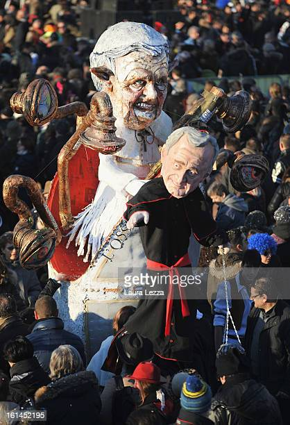 A giant paper mache float representing Pope Benedict XVI moves through the streets of Viareggio during the traditional Carnival parade on February 10...