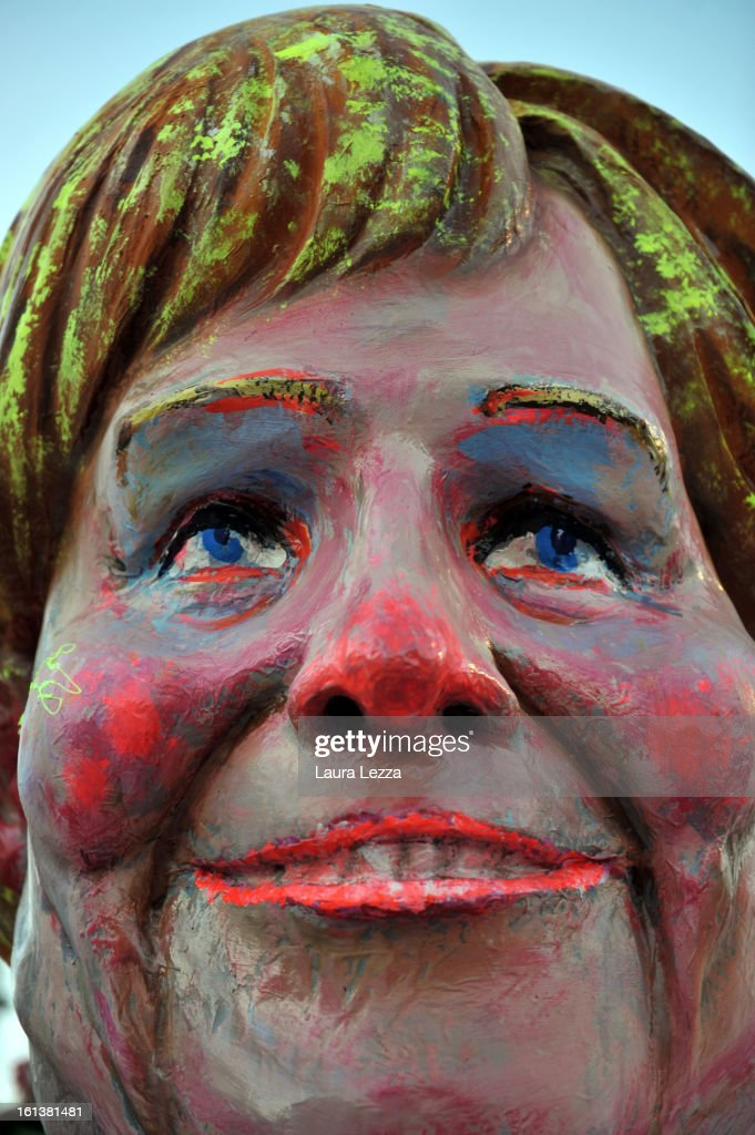 A giant paper mache float representing the Chancellor of Germany Angela Merkel moves through the streets of Viareggio during the traditional Carnival parade on February 10, 2013 in Viareggio, Italy. The Carnival of Viareggio is considered one of the most important carnivals in Italy and is characterised by its giant paper mache floats representing caricatures of popular characters, politicians and fictional creations.