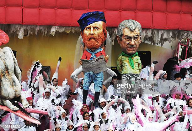 A giant papier maché float representing Giuseppe Garibaldi with an erection parades through the streets of Viareggio during the first traditional...