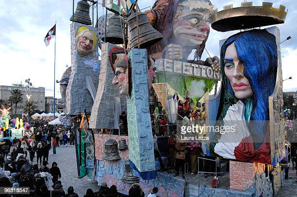 A giant papiermaché float representing Silvio Berlusconi his wx wife Veronica Lario and others Italian politicians parades through the streets of...