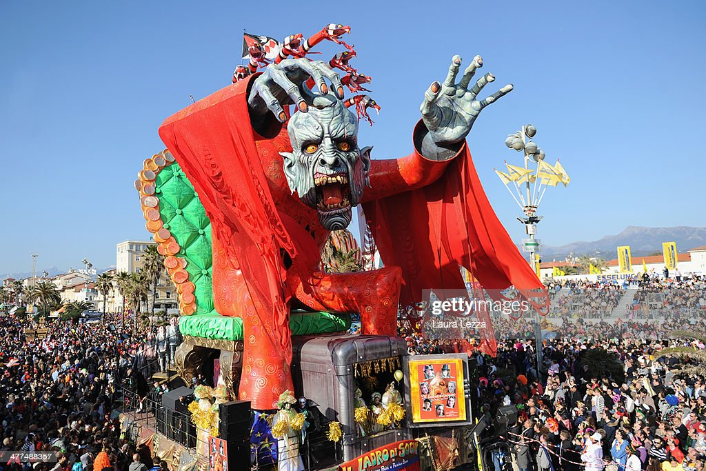 A giant papier-mache float moves through the streets of Viareggio during the traditional Carnival parade on March 9, 2014 in Viareggio, Italy. The Carnival of Viareggio is considered one of the most important carnivals in Italy and is characterised by its giant papier-mache floats representing caricatures of popular characters, politicians and fictional creations.
