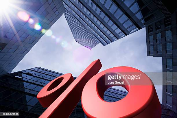 Giant percent sign and office buildings