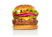 Perfect hamburger classic burger american cheeseburger isolated hamburger with sesame seed bun and extra toppings of tomatoes pickles onion and cheddar cheese