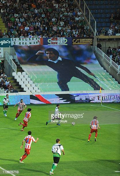 A giant photograph of the late Spanish golf legend Seve Ballesteros looks down during the La Liga match between Racing Santander and Atletico Madrid...