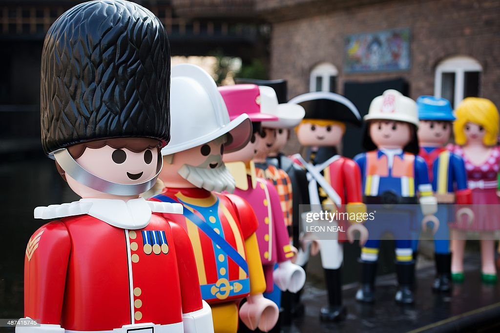 Giant Playmobil figures are displayed during a photocall on the canalside at Camden in north London, on April 30, 2014, as the toy company celebrates its 40th anniversary.