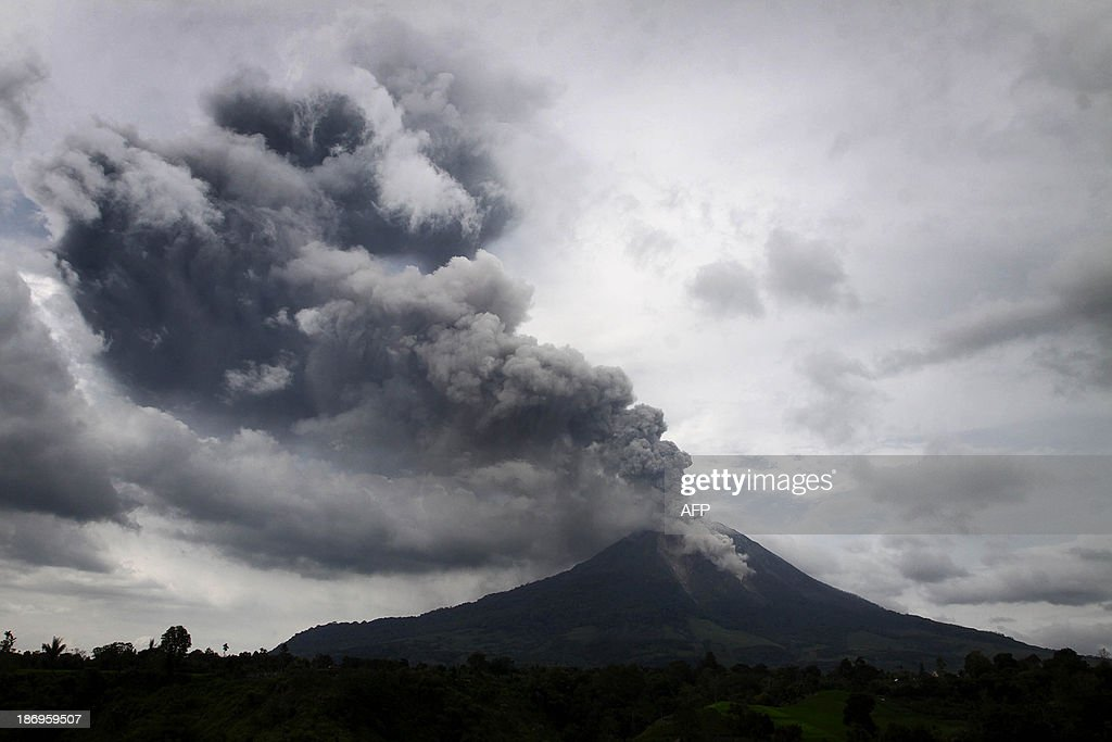 A giant plume of steam and ash rises from the crater of Mount Sinabung volcano during an eruption as seen from Karo district on Indonesia's Sumatra island on November 5, 2013. Hundreds of residents have been evacuated to safer areas as the volcano erupted anew following September eruptions.