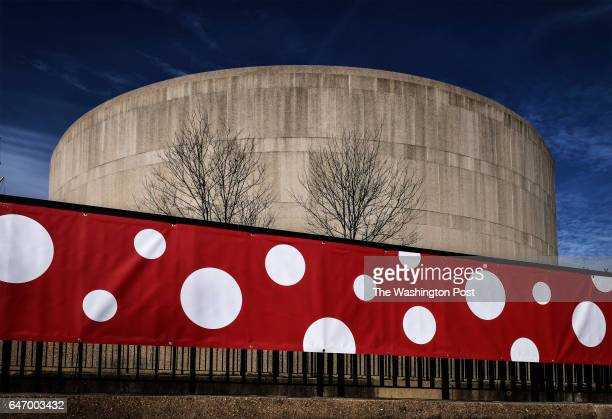 A giant polka dot ribbon circles the Hirshhorn museum for 'Yayoi Kusama Infinite Mirrors' which is due to open this week on February 2017 in...
