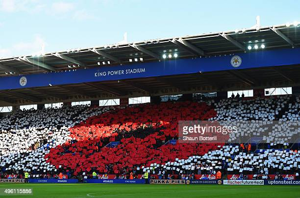 A giant poppy is formed by supporters to remember fallen members of the armed forces ahead of Remembrance Day prior to the Barclays Premier League...