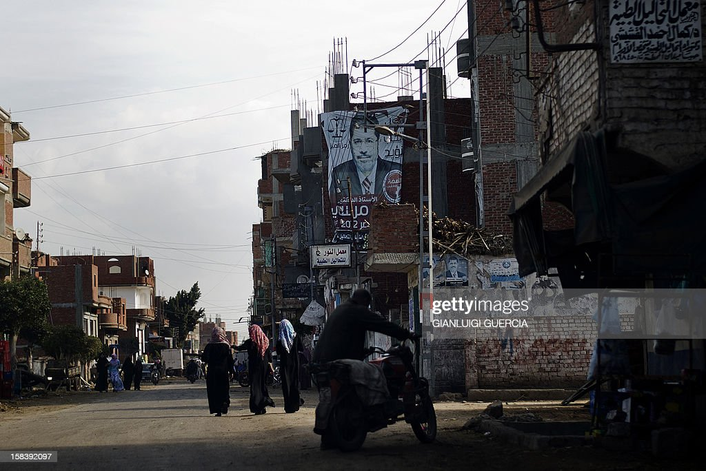 A giant portrait of Egyptian President Mohamed Morsi hangs from a building in his hometown Adwa in the Nile Delta on December 15, 2012. Egypt's opposition cried fraud in the first round of a divisive referendum on a new constitution, accusing Morsi's Muslim Brotherhood of rigging votes to adopt the Islamist-backed text.