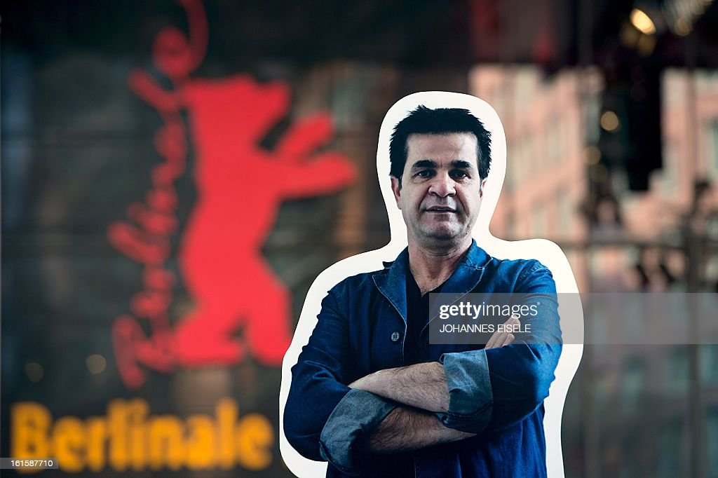 A giant poster featuring Iranian director Jafar Panahi is displayed in front of the Berlinale Festival Palace during a protest action against his non-attendance at the festival where the film 'Parde'('Closed Curtain') he codirected with Kambuzia Partovi is presented in the competition section of the 63rd Berlinale Film Festival on February 12, 2013. Panahi, a film-maker repeatedly acclaimed at major international festivals for gritty and socially critical movies that are banned in Iran, could not attend the Berlinale as he is placed under house arrest after being sentenced for a documentary he tried to make on the unrest following the 2009 election.
