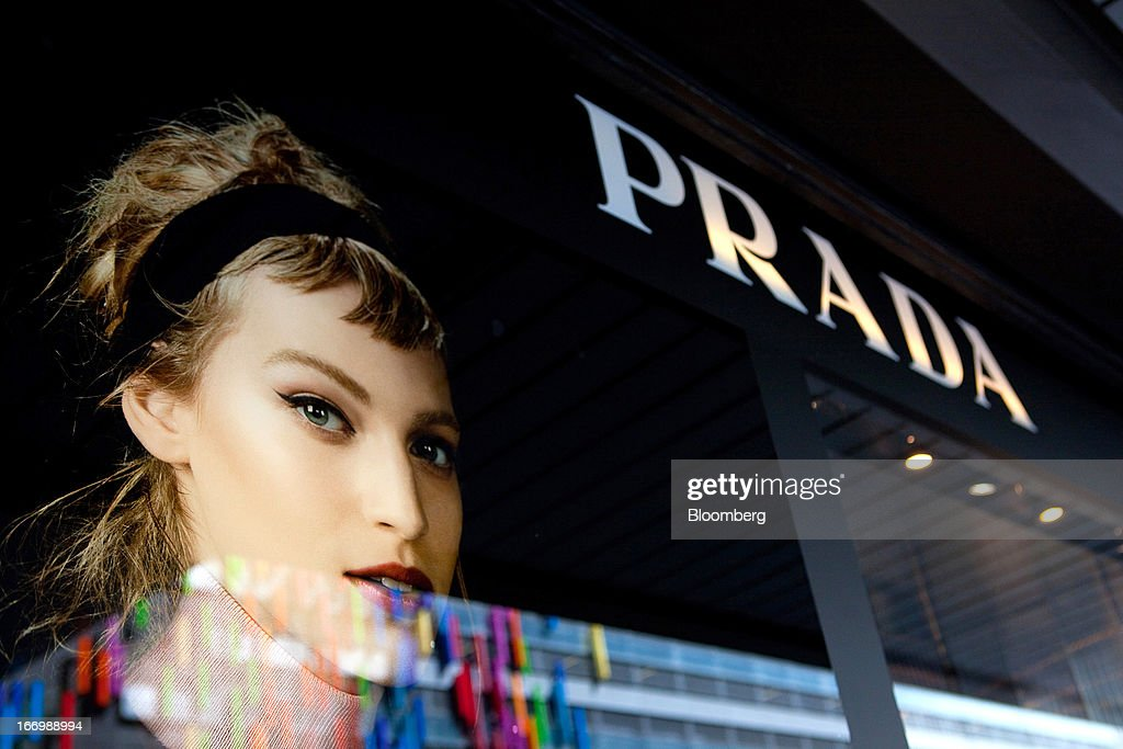 A giant poster is seen in the window of a Prada SpA store in Berlin, Germany, on Thursday, April 18, 2013. Germany's economy is shrugging off a contraction at the end of last year and starting to grow due to revived exports and rising private consumption, the country's leading economic institutes said. Photographer: Krisztian Bocsi/Bloomberg via Getty Images