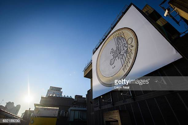 A giant poster of a Euro coin is seen on the Southbank on January 20 2017 in London England Following the announcement by Britain's Prime Minister...