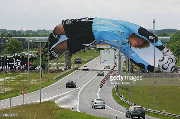 A giant poster of German National Goalkeeper Oliver Kahn is unveiled at the Munich Airport on May 27 2006 in Munich Germany The 65 meter long poster...