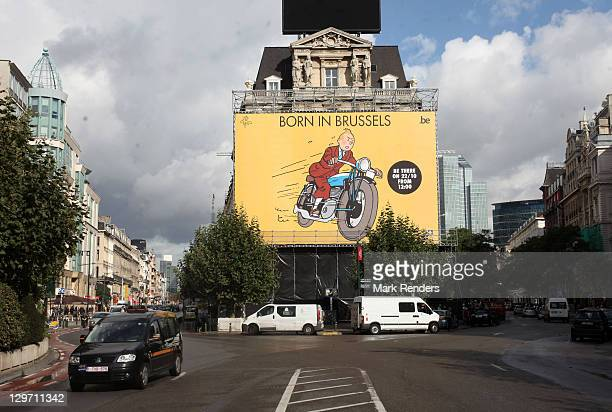 A giant poster of Tintin is displayed above the Tintin route at Place de Brouckere on October 19 2011 in Brussels Belgium