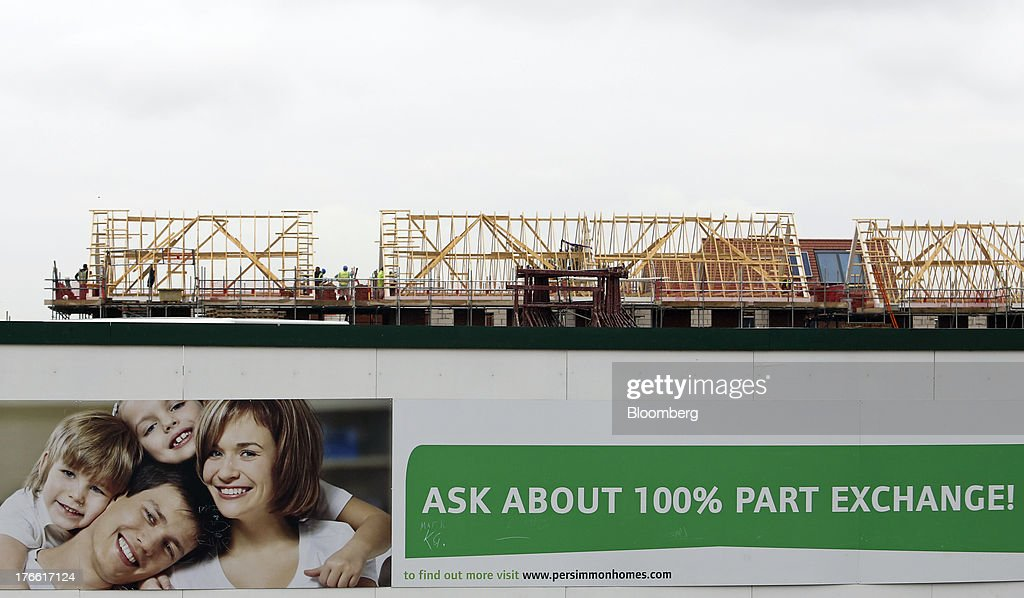 A giant poster on construction hoardings promotes part-exchange deals outside a Persimmon Plc residential housing site in South Ockenden, U.K., on Friday, Aug. 16, 2013. Persimmon, the largest homebuilder by market value, said in July that its operating margin widened to about 15 percent during the half from 12.1 percent. Photographer: Chris Ratcliffe/Bloomberg via Getty Images