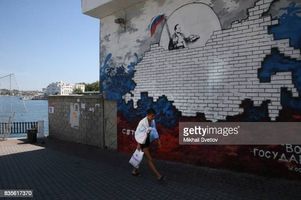 A giant poster with portrait of Russian President Vladimir Putin is seen on the street in Sevastopol Crimea August 19 2017 Sevastopol is located in...