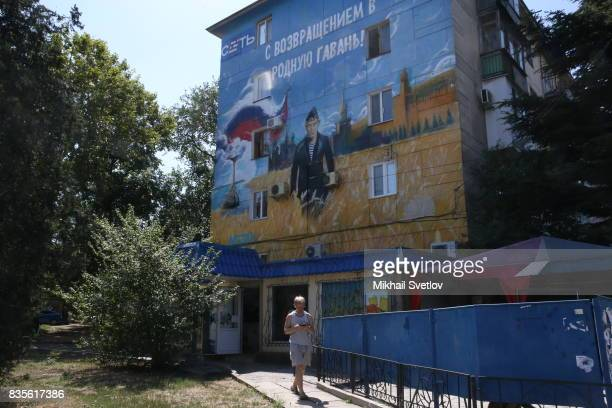 A giant poster with portrait of Russian President Vladimir Putin is seen on the street in Sevastopol Crimea August 19 2017 Poster reads 'Welcome back...