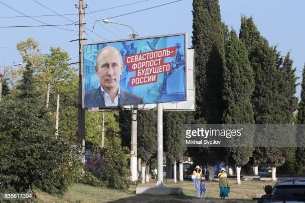 A giant poster with portrait of Russian President Vladimir Putin is seen on the street in Sevastopol Crimea August 19 2017 Poster reads 'Sevastopol...