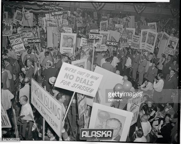 Giant posters of Presidential hopeful Harold E Stassen obscure most of the demonstrators and cause a 230 AM traffic jam in Convention Hall as...