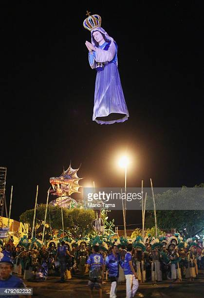 A giant puppet of the Virgin Mary hovers at the Parintins Folklore Festival in a town located along the Amazon River on June 27 2015 in Parintins...