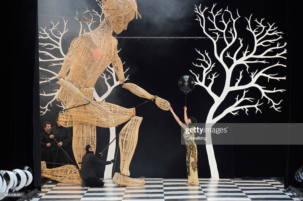 A giant puppet walks the runway at the Frank Sorbier Spring Summer 2014 fashion show during Paris Haute Couture Fashion Week on January 22, 2014 in Paris, France.