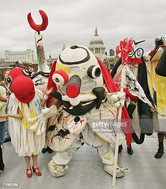 Giant puppets designed by the world famous Spanish artist Joan Miro cross the Millennium Bridge on their way to perform a play 'Merma Never Dies' at...
