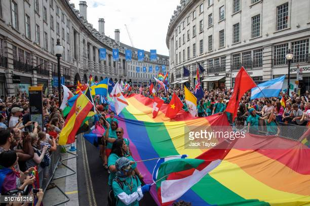 A giant rainbow flag is carried down Regent Street during the Pride in London Festival on July 8 2017 in London England The Pride in London Festival...