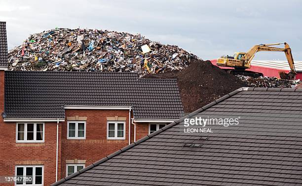 A giant refuse heap is visibile over the rooftops of a housing estate in Brierley Hill West Midlands on January 24 2012 Despite claims from Brierley...