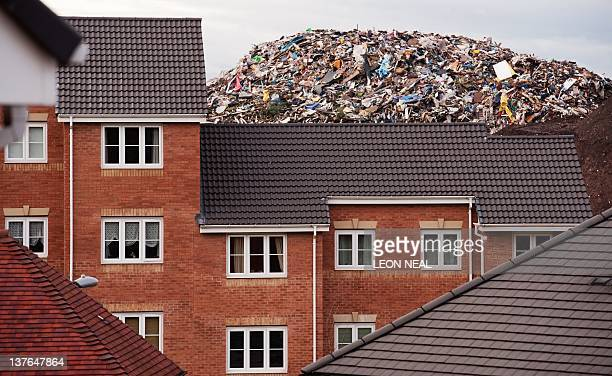 A giant refuse heap is visible over the rooftops of a housing estate in Brierley Hill West Midlands on January 24 2012 Despite claims from Brierley...
