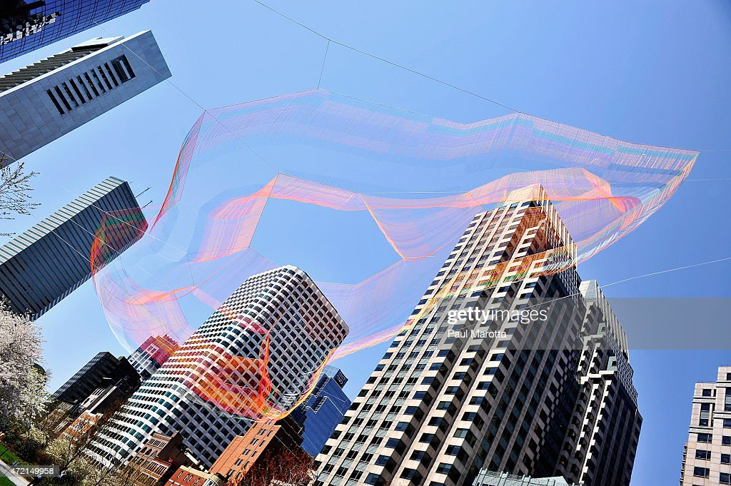 A giant rope sculpture by Brookline, MA artist Janet Echelman is suspended over the Rose Fitzgerald Kennedy Greenway on May 4, 2013 in Boston. The sculpture contains 100 miles of rope, weighs more than a ton and is more than 270 feet in length at its longest point.