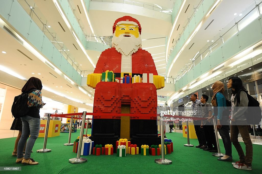 Giant Santa Claus LEGO displays at Ciputra World Mall on December 19, 2013 in Surabaya, Indonesia. It's height is 5,2 meters, diameter 2,5 meters, consist of 500.000 loose LEGO bricks, made within 5 months and breaks the Indonesian Museum of Record for Biggest Santa Claus Replica from LEGO Bricks. Indonesian Christians celebrate holiday season while on December 12, Indonesian police warned that Islamic extremists may be planning to target worshipers at Christmas and New Years celebrations in the capital Jakarta and other parts of the country.