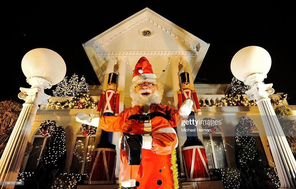 A giant Santa Claus sits in front of a decorated house on Christmas Eve December 24, 2012 in the Dyker Heights neighborhood of the Brooklyn borough of New York City. The neighborhood in the south part of the borough, is known for its yearly display of over the top holiday themed decorations.