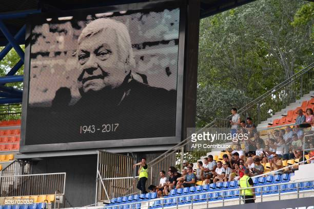 A giant screen displays a tribute image to Montpellier's late president Louis Nicollin prior to the French L1 football match between Montpellier and...