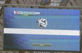 A giant screen in the stadium gives a goal using the new goal line technology during a Group E football match between France and Honduras at the...