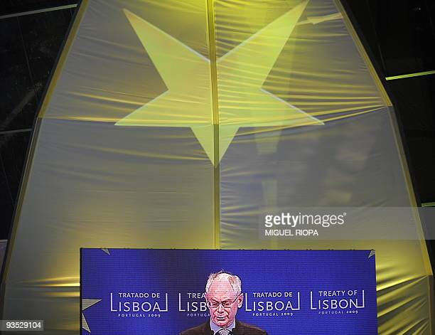 A giant screen projects the image of New European Union President Belgian Herman Van Rompuy during the ceremony to mark the entry into force of the...