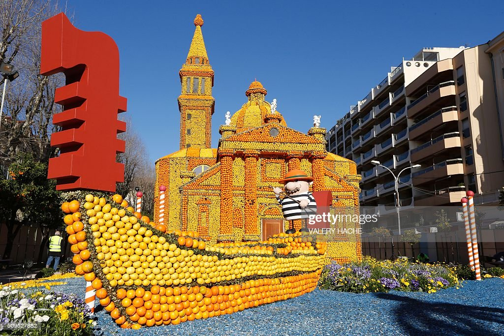Giant sculptures of a gondola and a church decorated with oranges and lemons are pictured in Menton on the French Riviera on February 11, 2016, ahead of the start of the 'Fete du Citron' (Lemon Festival). The theme of this 83rd edition, running from February 13 until March 2, 2016, is called 'Cinecitta'. / AFP / VALERY HACHE