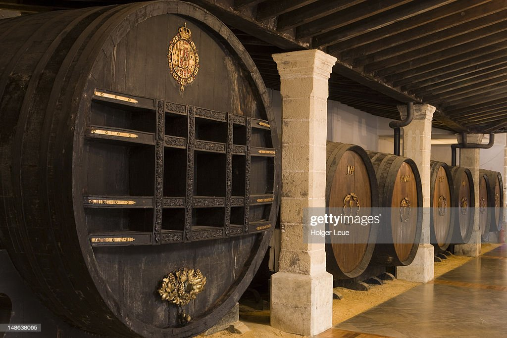 Giant sherry casks in cellar of Bodega Tio Pepe Gonzales Byass.